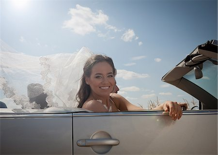 Newlywed couple driving in convertible Stock Photo - Premium Royalty-Free, Code: 649-06432549