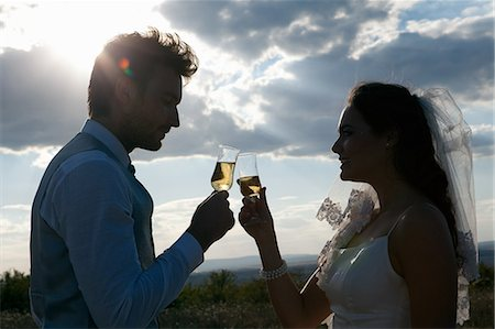 Newlywed couple having champagne Stock Photo - Premium Royalty-Free, Code: 649-06432575