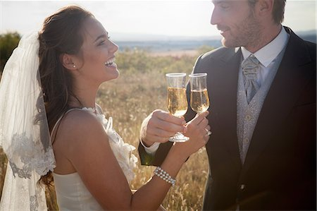 Newlywed couple having champagne Stock Photo - Premium Royalty-Free, Code: 649-06432573