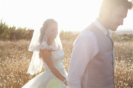 Newlywed couple walking outdoors Stock Photo - Premium Royalty-Free, Code: 649-06432586