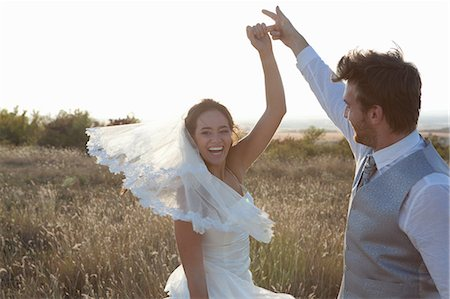 Newlywed couple dancing outdoors Stock Photo - Premium Royalty-Free, Code: 649-06432591