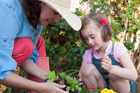 Mother and daughter gardening together Stock Photo - Premium Royalty-Free, Code: 649-06432660