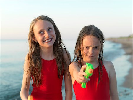 Girls playing on beach together Stock Photo - Premium Royalty-Free, Code: 649-06432696