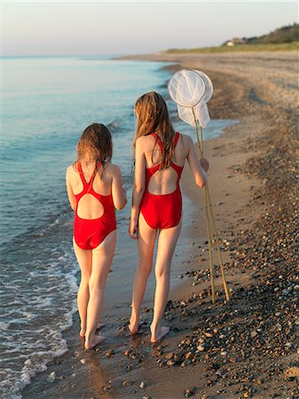 Girls walking on rocky beach Stock Photo - Premium Royalty-Free, Code: 649-06432697