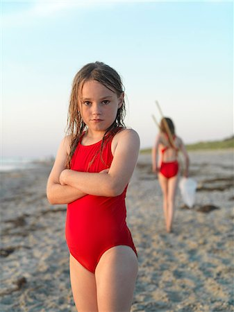 preteen bathing suit - Girl standing on sandy beach Stock Photo - Premium Royalty-Free, Code: 649-06432698