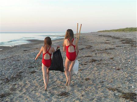 preteen swimsuit - Girls walking on sandy beach Stock Photo - Premium Royalty-Free, Code: 649-06432699