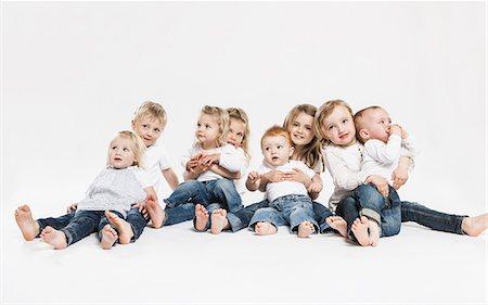 Smiling children posing together Stock Photo - Premium Royalty-Free, Code: 649-06432742