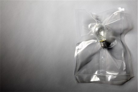 Light bulb shrink wrapped in plastic Stock Photo - Premium Royalty-Free, Code: 649-06432774