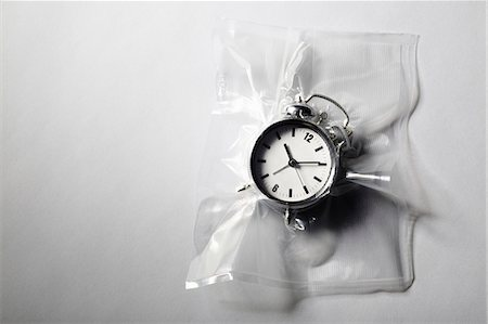 Alarm clock shrink wrapped in plastic Stock Photo - Premium Royalty-Free, Code: 649-06432779