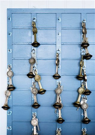 Keys handing from key hooks Stock Photo - Premium Royalty-Free, Code: 649-06432876