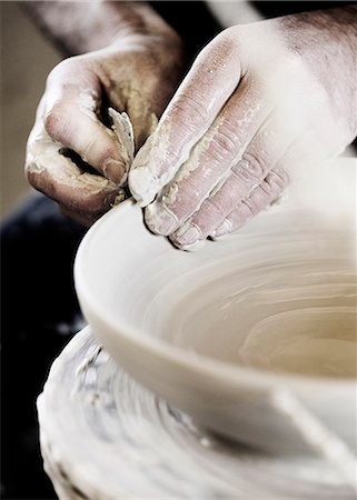 Potter creating handcrafted bowl in shop Stock Photo - Premium Royalty-Free, Code: 649-06432879