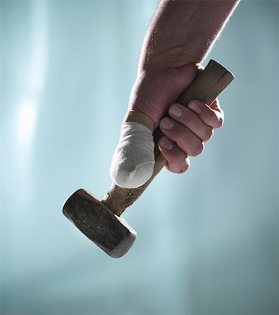Close up of bandaged thumb and mallet Stock Photo - Premium Royalty-Free, Code: 649-06432990