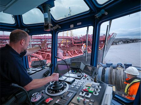 ships at sea - Worker driving tugboat in wheelhouse Stock Photo - Premium Royalty-Free, Code: 649-06433066