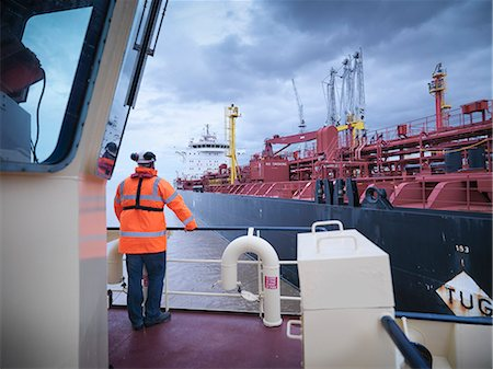 ships at sea - Tugboat worker standing on deck Stock Photo - Premium Royalty-Free, Code: 649-06433067