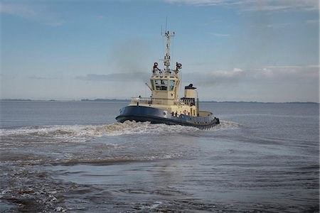 property release - Tugboat sailing in water Stock Photo - Premium Royalty-Free, Code: 649-06433096