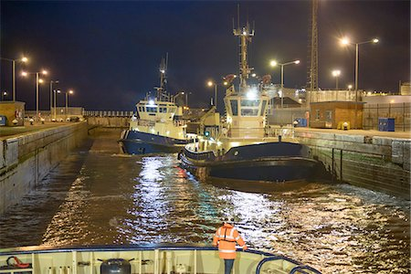 property release - Tugboats docked in harbor at night Stock Photo - Premium Royalty-Free, Code: 649-06433107