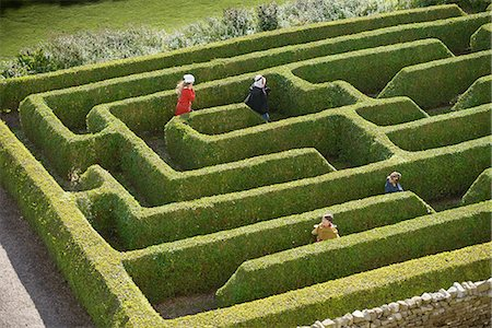 Students exploring hedge maze Stock Photo - Premium Royalty-Free, Code: 649-06433125