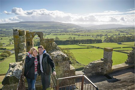 Couple standing on medieval ruins Stock Photo - Premium Royalty-Free, Code: 649-06433126
