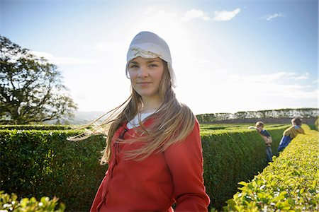 preteen beauty - Student in period dress in hedge maze Stock Photo - Premium Royalty-Free, Code: 649-06433149