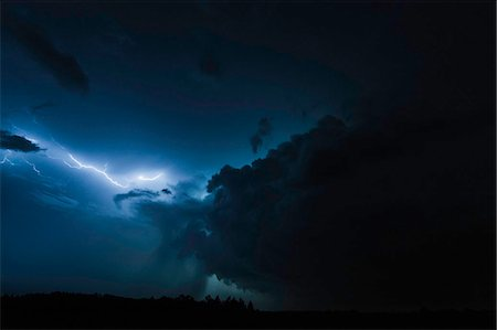 Lighting clouds over rural landscape Stock Photo - Premium Royalty-Free, Code: 649-06433197
