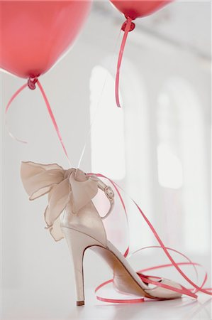 femininity - Balloons attached to high heel Stock Photo - Premium Royalty-Free, Code: 649-06433206