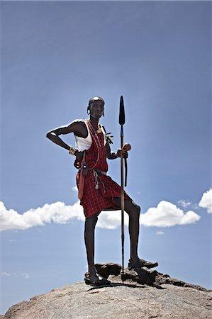Maasai man standing on top of rock Stock Photo - Premium Royalty-Free, Code: 649-06433214
