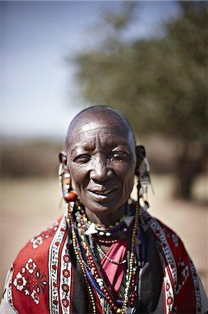 Smiling Maasai woman wearing jewelry Stock Photo - Premium Royalty-Free, Code: 649-06433217