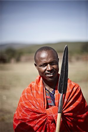 Maasai man holding shovel Stock Photo - Premium Royalty-Free, Code: 649-06433218