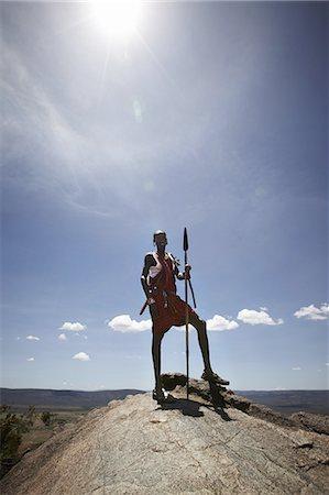 Maasai man standing on top of rock Stock Photo - Premium Royalty-Free, Code: 649-06433219