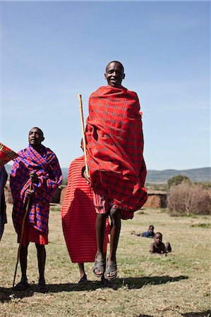 Maasai people walking in grassy field Stock Photo - Premium Royalty-Free, Code: 649-06433211