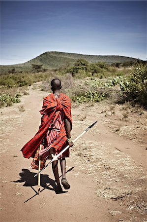 Maasai man walking on dirt road Stock Photo - Premium Royalty-Free, Code: 649-06433212