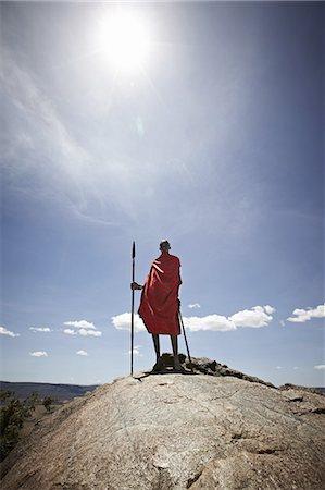 Maasai man standing on top of rock Stock Photo - Premium Royalty-Free, Code: 649-06433220