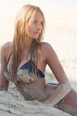Woman in bikini laying on beach Stock Photo - Premium Royalty-Free, Code: 649-06433272