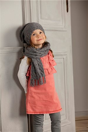Smiling girl wearing hat and scarf Stock Photo - Premium Royalty-Free, Code: 649-06433317