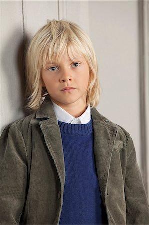 preteen long hair - Boy leaning against door Stock Photo - Premium Royalty-Free, Code: 649-06433335