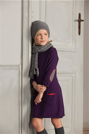 portrait looking away - Girl wearing scarf and hat indoors Stock Photo - Premium Royalty-Free, Code: 649-06433340
