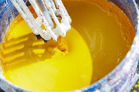 production - Vat of yellow paint being mixed Stock Photo - Premium Royalty-Free, Code: 649-06433372