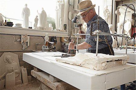 Worker chiseling slab of stone Stock Photo - Premium Royalty-Free, Code: 649-06433435
