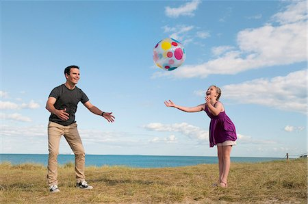 Father and daughter playing together Stock Photo - Premium Royalty-Free, Code: 649-06433476