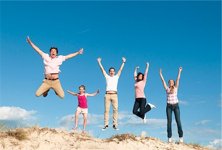 five - Family cheering together on sand dune Stock Photo - Premium Royalty-Free, Code: 649-06433488