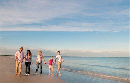 partnership - Family walking together on beach Stock Photo - Premium Royalty-Free, Code: 649-06433501