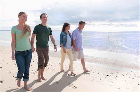 Couples holding hands on beach Stock Photo - Premium Royalty-Free, Code: 649-06433512