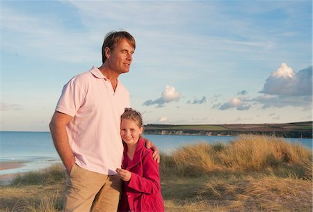 Father and daughter hugging on beach Stock Photo - Premium Royalty-Free, Code: 649-06433543