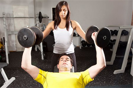Man working with trainer at gym Stock Photo - Premium Royalty-Free, Code: 649-06433561