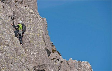 rock climber - Climber scaling steep rock face Stock Photo - Premium Royalty-Free, Code: 649-06433587