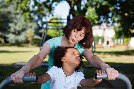 exterior bar - Woman and granddaughter playing in park Stock Photo - Premium Royalty-Free, Code: 649-06433614