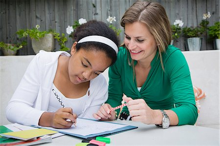 Student working with teacher outdoors Stock Photo - Premium Royalty-Free, Code: 649-06433626