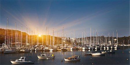 sailboat  ocean - Boats docked in rural harbor Stock Photo - Premium Royalty-Free, Code: 649-06433675