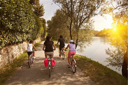 recreation - Family riding bicycles by river bank Stock Photo - Premium Royalty-Free, Code: 649-06433679