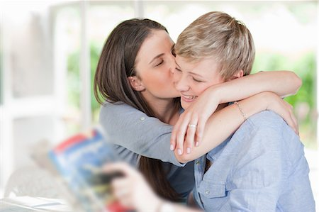 Woman kissing smiling girlfriend Stock Photo - Premium Royalty-Free, Code: 649-06488422